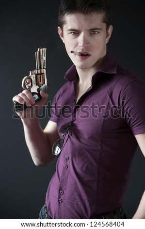 attractive man with a gun - stock photo
