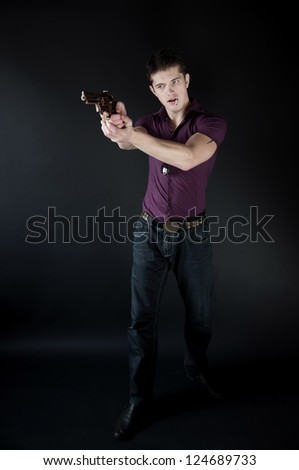 attractive man with a gun