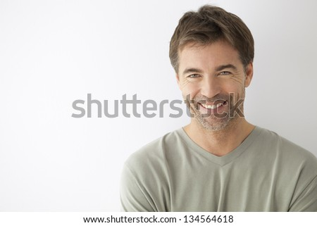 Attractive Man With Toothy Smile On A White Background