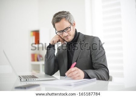 attractive man working in office - stock photo