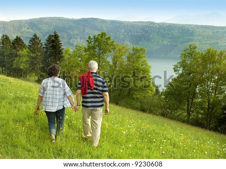 "attractive married mature couple enjoying the nature. keyword for this collection is ""seniors77"" - stock photo"