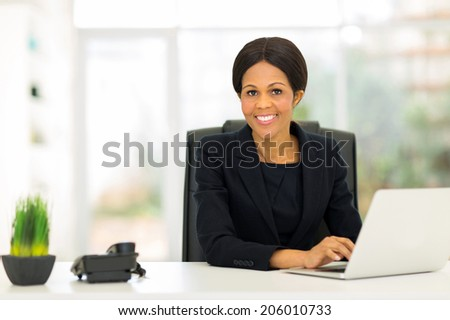 attractive mature afro american business woman using computer in office