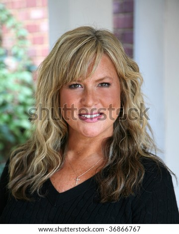 Attractive, mature blond haired business woman - stock photo