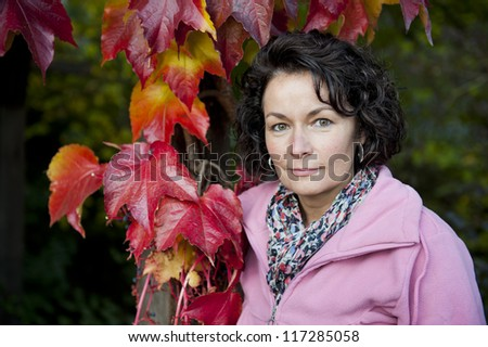 attractive mature woman in autumn