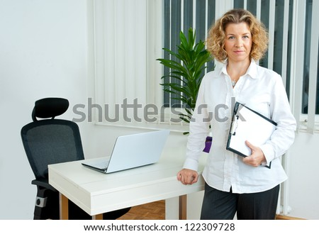 attractive mature woman in her office - stock photo