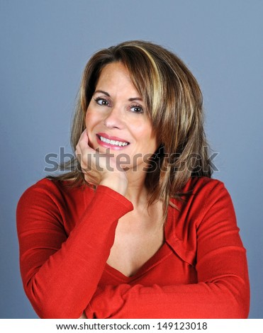 Attractive Mature Woman Wearing a Red Sweater - stock photo