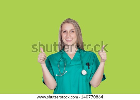 Attractive medical girl saying ok on a green background
