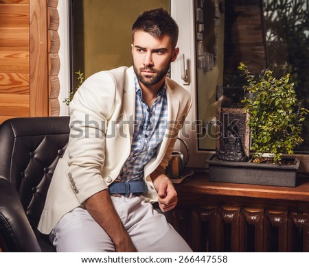Attractive men indoor. Close-up photo. - stock photo