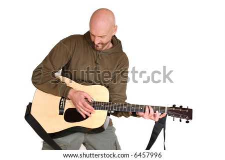 Attractive, mid fifties bearded middle aged man playing the guitar.  Casual dressed. - stock photo