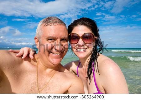 Attractive middle age couple selfie enjoying beautiful Miami Beach. - stock photo