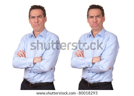 Attractive Middle Age Man in Blue Shirt with Grumpy Unhappy Expression and Wobbly Lower Lip with Arms Folded