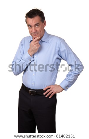 Attractive Middle Age Man in Blue Shirt with Thoughtful Expression and Hand on Hip