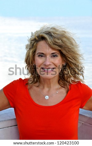 Attractive Middle Age Woman Wearing a Red Shirt - stock photo