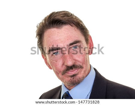 Attractive middle aged business man with intense blue eyes. Studio shot over white with space for text.
