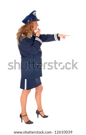 Attractive middle aged female police officer blowing the whistle. White background