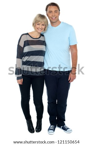 Attractive middle aged love couple. Full length studio shot on white background. - stock photo
