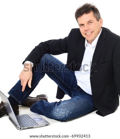 Attractive middle-aged man using notebook computer. All on white background.