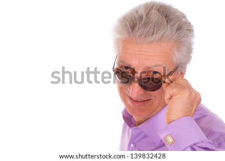 Attractive middle-aged man with sunglasses on a white background - stock photo