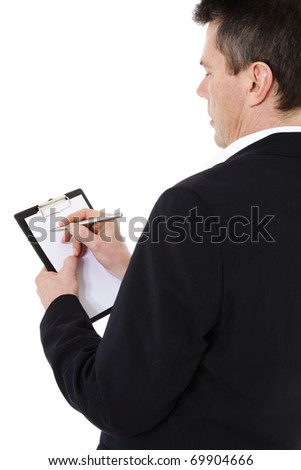 Attractive middle-aged man writing on clipboard. All on white background.