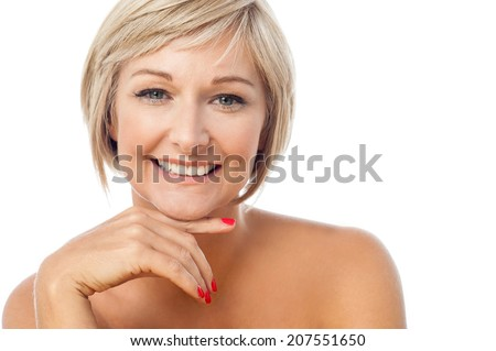 Attractive middle aged posing, hands on chin - stock photo