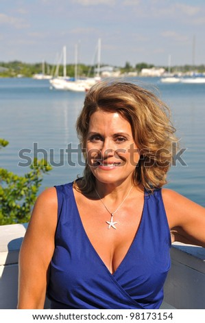 Attractive Middle Aged Woman in Blue Summer Dress - stock photo