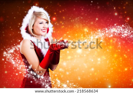 attractive miss santa with twinkling stars  - stock photo