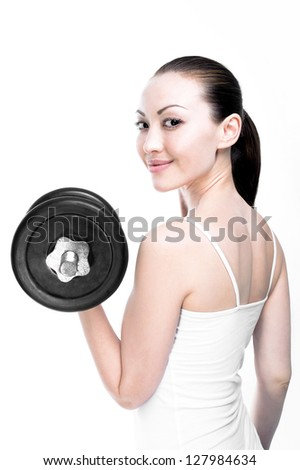 Attractive Mixed Asian Female smiling with dumbbells