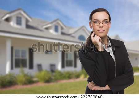 Attractive Mixed Race Woman in Front of Beautiful New Residential House. - stock photo