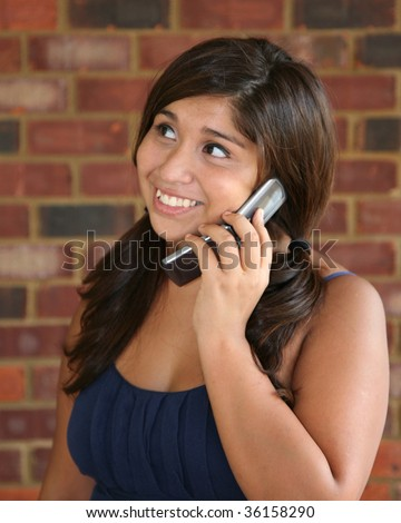 Attractive mixed race woman on cell phone - stock photo