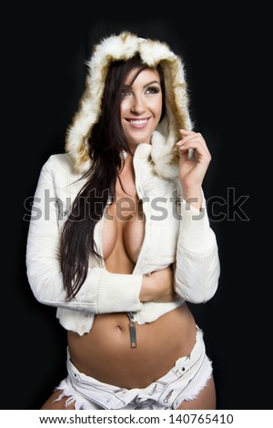 Attractive model poses with a white winter coat - stock photo