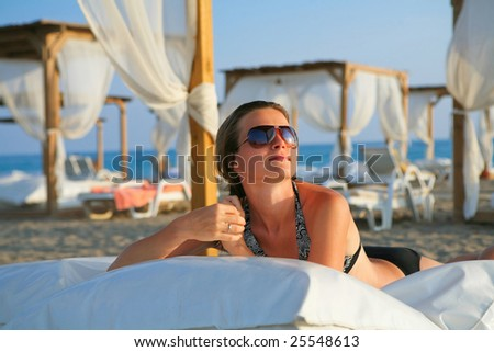 Attractive model resting in the tropical beach