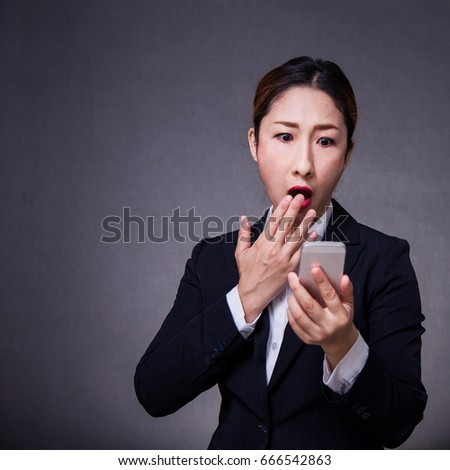 Attractive Modern asian business woman model with Black hair in Suit Playing Smart Phone different emotion such as  Angry,edgy,shock,be smile,love,wow,glad,cheer,Press the button, internet of things