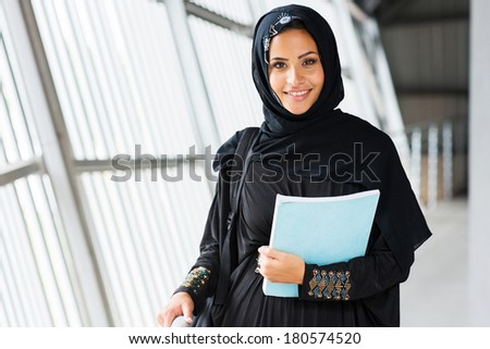 attractive modern islamic college girl on campus - stock photo