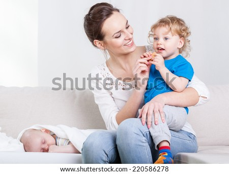 Attractive mother and her sons at home - stock photo