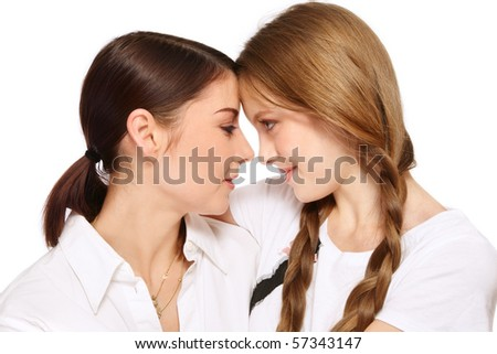 Attractive mother and pretty teen daughter talking, on white background - stock photo