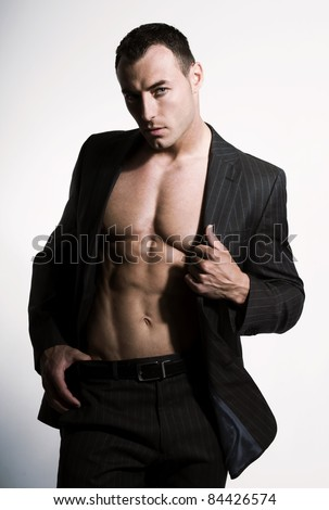 Attractive, muscular man posing - stock photo