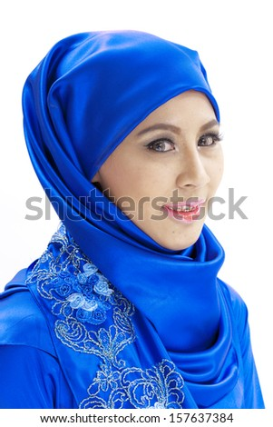 Attractive Muslim woman on isolated white background