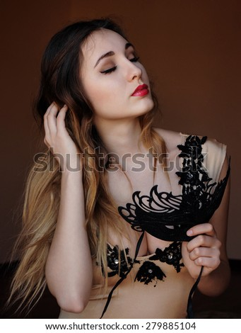 attractive mysterious elegant young girl with black mask evening - stock photo