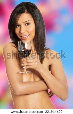 Attractive naked woman with galss of wine.