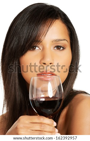 Attractive naked woman with glass of wine. Closeup. Isolated on white.