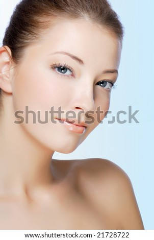Attractive natural woman face isolated on white - stock photo