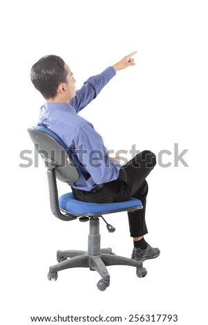 attractive of businessman sitting and pointing