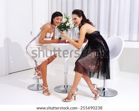 Attractive office women on coffee break making mobile phone call, smiling - stock photo