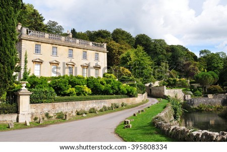 Attractive Old Mansion House and Driveway in the English Countryside - stock photo