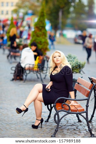 attractive overweight woman in the city - stock photo