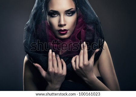 attractive passionate woman in black hood