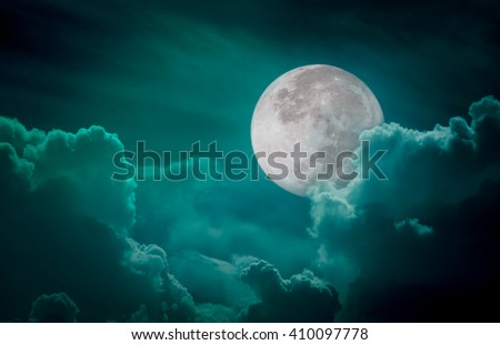 Attractive photo of a nighttime green sky with clouds, bright full moon would make a great background. Nightly sky with large moon. Beautiful nature use as background. Outdoors. - stock photo