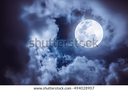 Attractive photo of a nighttime sky with cloudy and bright full moon. Beautiful nature use as background. Outdoors. The moon were NOT furnished by NASA.