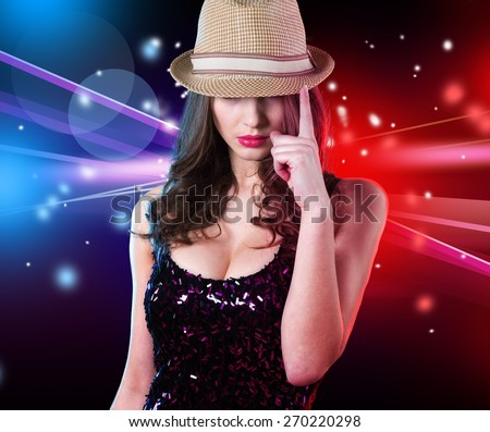 Attractive. Photo of blond woman wearing stylish shiny red hat, glamour singer girl with finger up isolated on blur lights background, New Year celebration, Christmas eve, night life, dance club party - stock photo