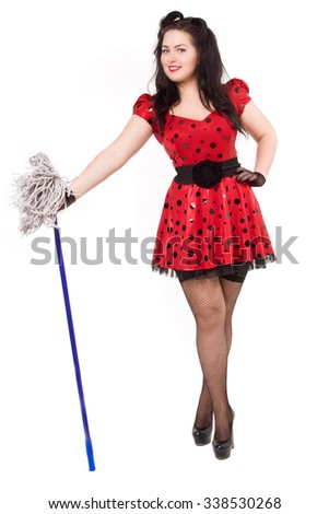 Attractive pin-up girl with a mop in his hands over white